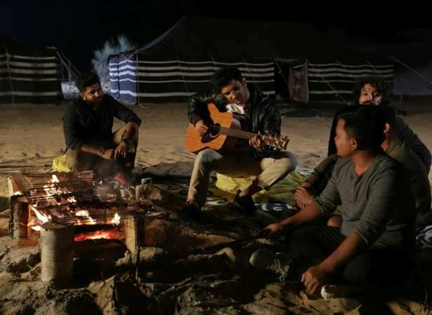 Sushant at a barbecue and guitar session in Dubai