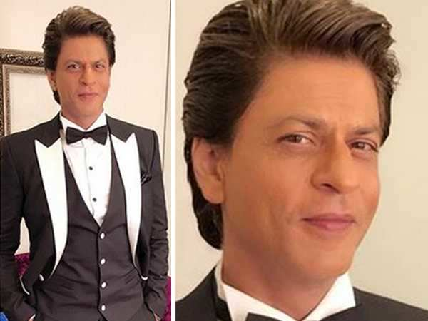 Dapper Daddy! Shah Rukh Khan sizzles in a black and white tuxedo