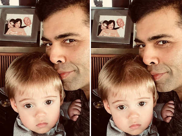 Karan Johar remembers his dad with his son Yash in his arms