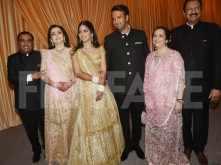 Isha Ambani and Anand Piramal arrive at their reception with family