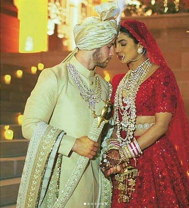 Nick Jonas and Priyanka Chopra got married earlier this month with a grand celebration in Jodhpur. Several guests of the couple flew in from overseas to attend various functions of the duo. Nick and Priyanka's wedding pictures and videos followed soon after. The couple broke the internet with their dreamlike pictures with the perfect setting and love-filled moments. NickYanka, as they are lovingly called, got married in two ceremonies. One was the white wedding conducted by Nick's dad Paul Kevin Jonas and other was the wedding according to Indian customs. After going through several pictures of the couple and their family members from the wedding, today ace designer Sabyasachi shared a few unseen pictures from the ceremony.     Priyanka is seen adoring Nick as they are sitting near the mandap in one picture. In another one Priyanka and Nick are posing with Madhu and Siddharth Chopra. If you haven't seen the latest pictures already, we've got you covered.