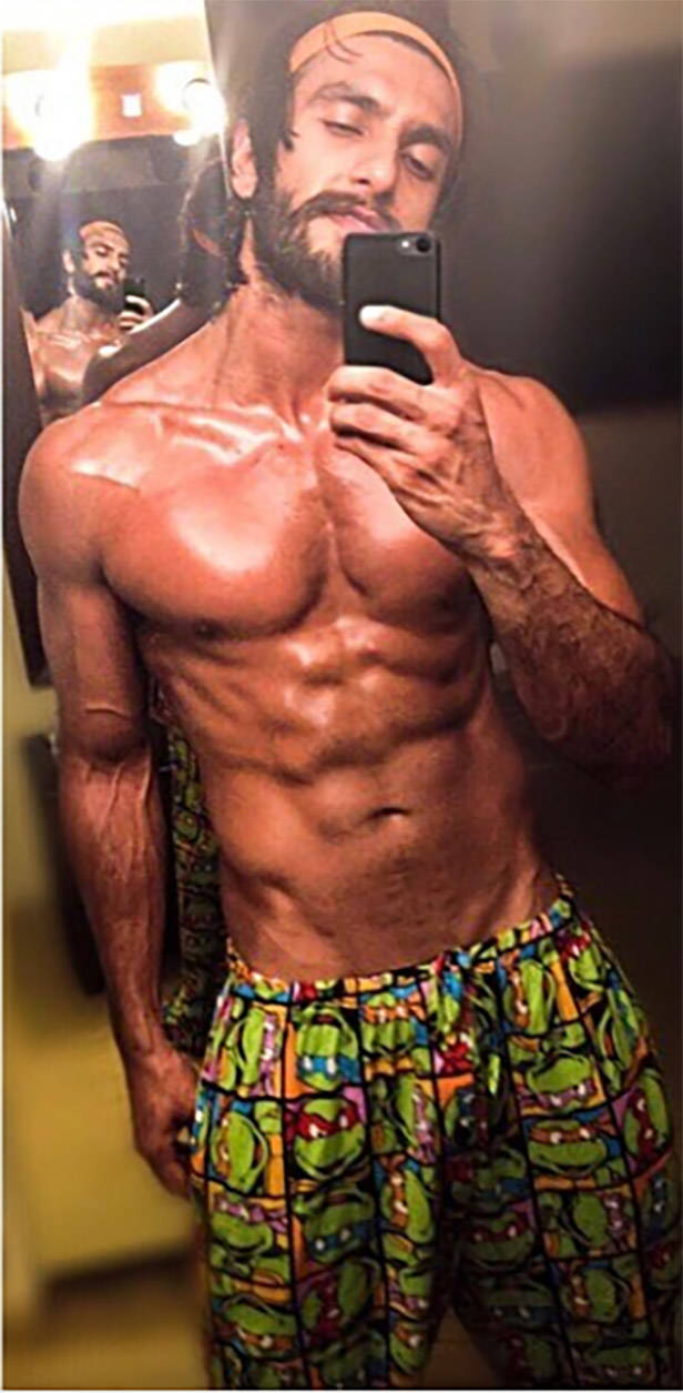 """Ranveer Singh's aura brings with it a vibe that radiates happiness and confidence. Wherever he walks in, the man grabs all the eyeballs and then keeps them glued. Ranveer's latest release Padmaavat was a massive success and his line-up for 2018-19 only spells more success. With films like Gully Boy, Simmba and '83, Ranveer is set to take his career to another level. Ranveer is full of humour, energy and talent and that's a big reason why he enjoys such a huge fan following.   Ranveer also has a body to die for. His body goes through a lot of transformation according to his roles. The actor took to Instagram this morning to share a little bit of advice with his followers, while showing off his to-die-for body. Ranveer looks shredded as hell in the latest post which he used as his Monday motivation for this week. The actor captioned his image, """"Cowabunga, dude! #Turtlepower #mondaymotivation."""" Too good, isn't it?"""
