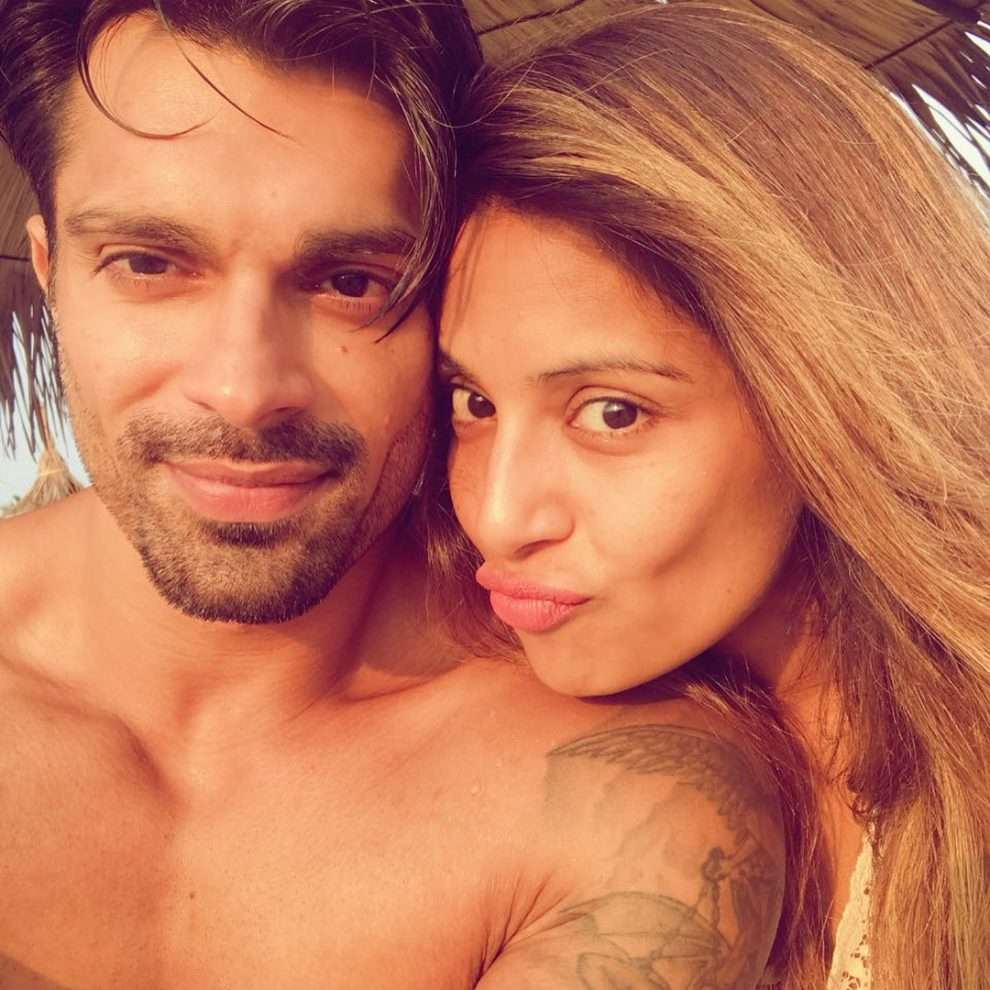 Karan Singh Grover and Bipasha Basu got married on April 30, 2016. Two years down the lane, the duo seems to have just fallen for each other even more. Bipasha and Karan keep their fans updated by posting pictures and videos of themselves and their whereabouts on social media. The couple is often seen enjoying on vacations as well as family dinners or during rigorous workouts. Bipasha and Karan recently celebrated their second wedding anniversary in Goa and the couple's chemistry looked phenomenal in all the pictures and videos.   Karan and Bipasha posted several glimpses of their trip to Goa with their close friends Rocky S and Deanne Panday. We can see the couple cutting an adorable cake with two monkeys hugging each other signifying monkey love, the kind of love the duo believes in. Karan and Bipasha can also be seen slow dancing on the beach in an extremely romantic set up in a video and the couple for sure gave a lot of love birds ideas on how to make their big day special. Scroll down to see all the pictures and videos.