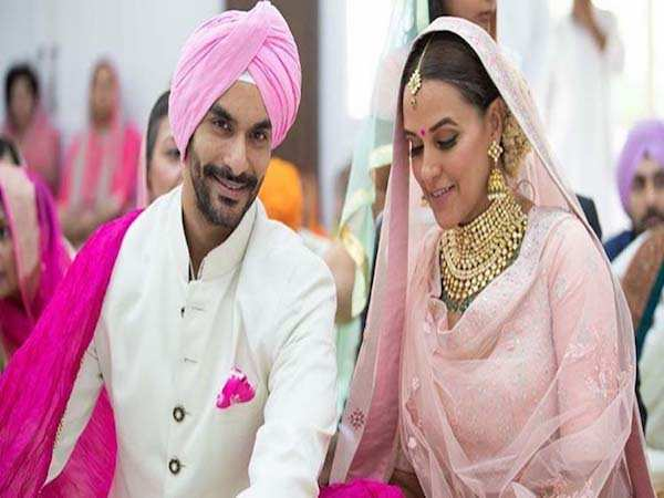 Karan Johar played cupid for Neha Dhupia and Angad Bedi