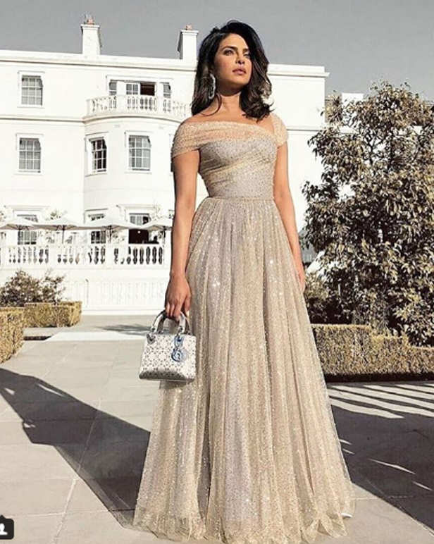 Priyanka Chopra spells charisma and style. The actress attended the biggest wedding of 2018, the union of Prince Harry and Meghan Markle at the Windsor Castle yesterday and later in the evening the actress made a sizzling appearance at the Royal reception as well. The party after the wedding was organized by Prince Charles, Prince Harry's father, at the Frogmore House and it was a private affair for only 200 close guests. Our very own Desi girl was one of the 200 attendees at the party and she surely made everyone back in India go gaga about her appearance. PeeCee looked elegant and classy in an embellished Dior gown with hues of light blue and cream perfectly knitting into one another. The global star also carried a small purse by Dior and wore a detailed pair of earrings. It is being said that the guests at the event danced away till late night and wrapped up the party when fireworks lit up Frogmore House last night.   We totally loved Priyanka's looks at the Royal affair. What about you?