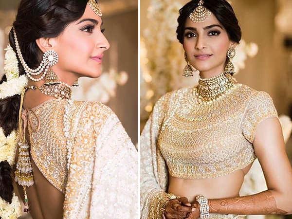 Sonam Kapoor looks breathtaking in white & gold at her Mehendi ceremony