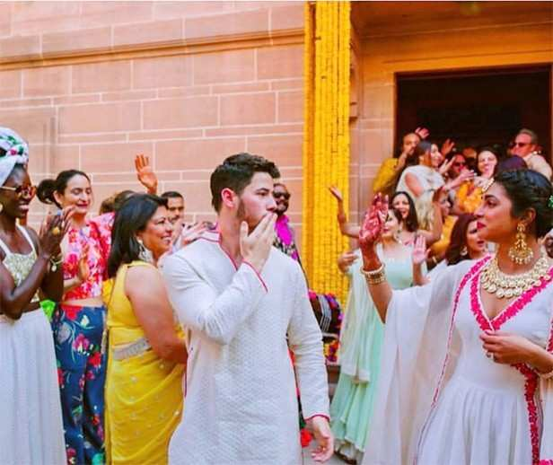 Nick Jonas blows a kiss to Priyanka Chopra in this unseen wedding picture