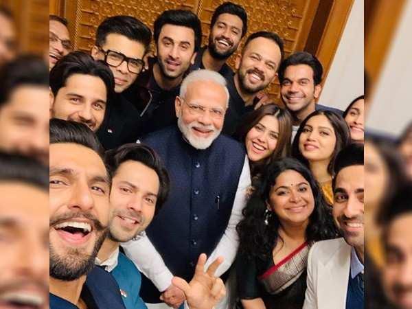 Stars pose for a happy picture with PM Narendra Modi in New Delhi
