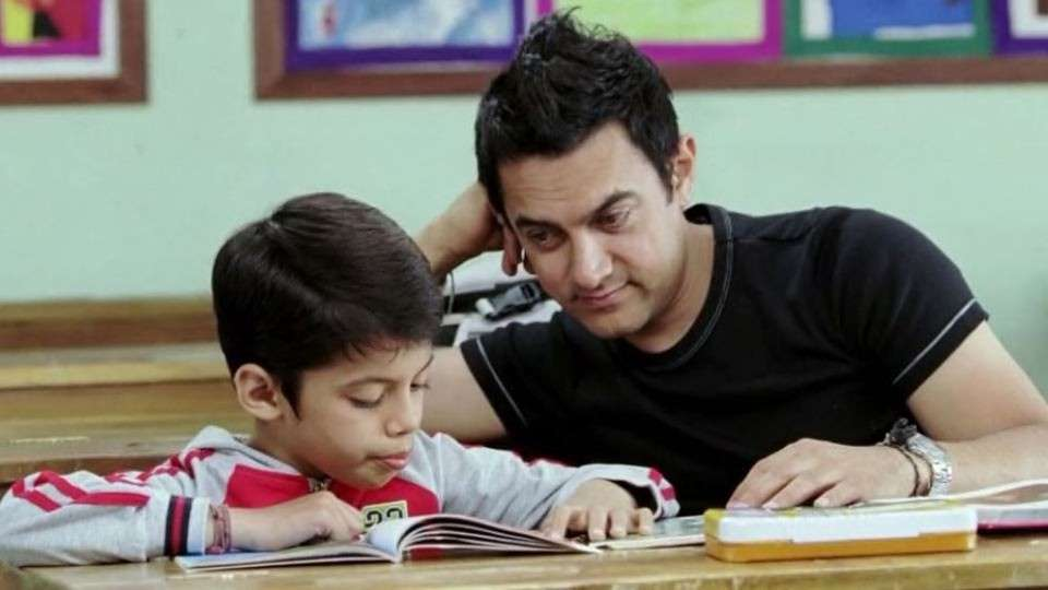 Aamir Khan as Ram Shankar Nikumbh in Taare Zameen Par  Aamir Khan stepped up as a director for the first time in Taare Zameen Par. He did not only direct but also played the central part in the film that was about a young boy suffering from Dyslexia and how Aamir being his teacher helped him through. The film showed the importance of a helpful teacher who understands his students rather than imposing one's views on them. TZP was a huge hit and struck a chord with the masses instantly.