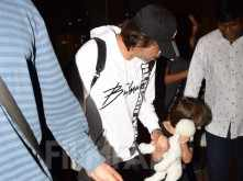 Photos: Shah Rukh Khan returns from London with son AbRam Khan