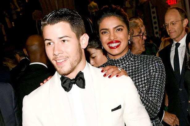 Nick Jonas plants a kiss on Priyanka Chopra at the Billboard Music Awards