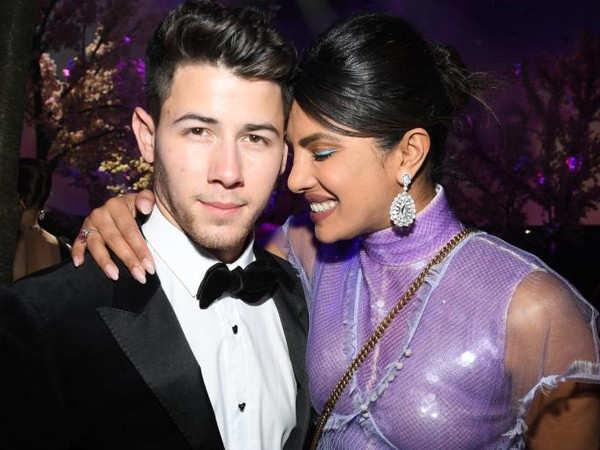 Priyanka Chopra showers kisses on Nick Jonas in a football stadium on his birthday