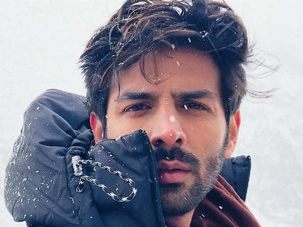 Kartik Aaryan has got back his OG hairstyle and has a quirky twist to reveal it!