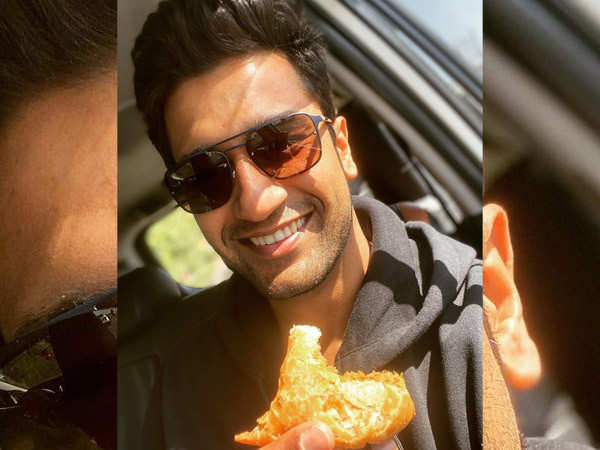 Vicky Kaushal receives some samosas and jalebi from a fan in Indore