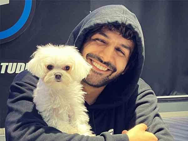 Kartik Aaryan's pictures with a furry pup are the cutest pics on the Internet