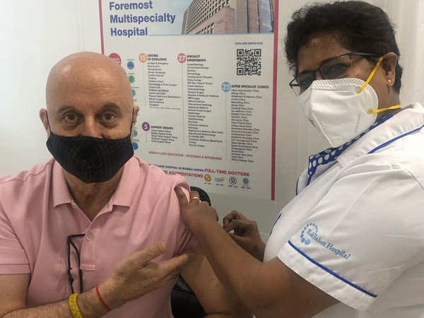 Anupam Kher shares video and pictures getting his first dose of COVID-19 vaccine