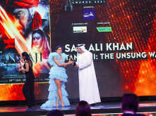 Dr. BU Abdullah and Sara Ali Khan present the Best Actor in a Supporting Role Award
