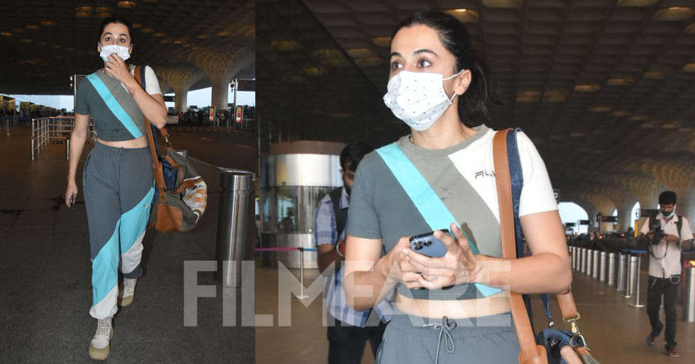 Taapsee Pannu poses for the paparazzi at the airport