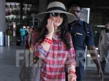 A very busy Preity Zinta clicked at the airport