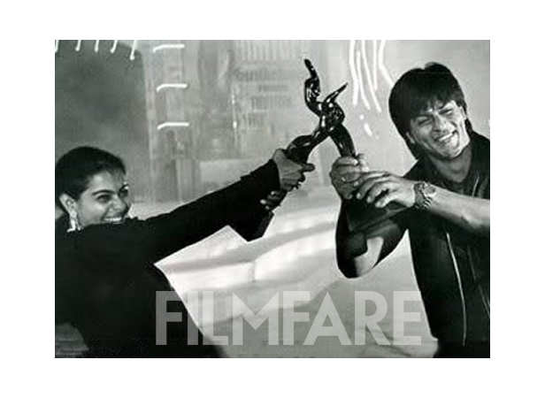 Kajol and Shah Rukh Khan with their Filmfare trophies