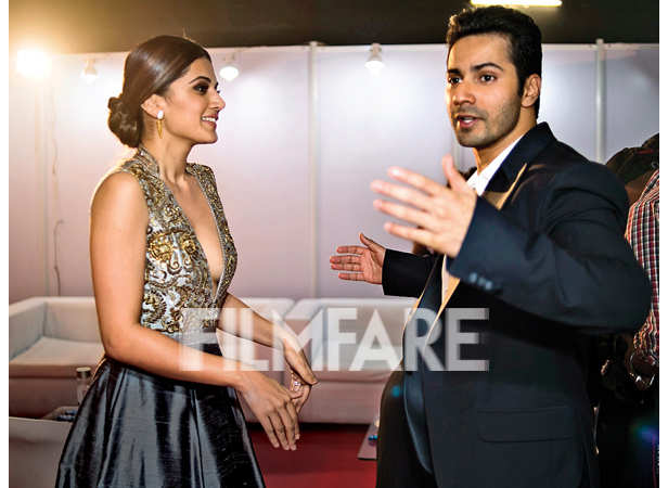 Taapsee Pannu and Varun Dhawan in an animated conversation