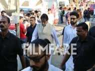 Amitabh and Abhishek Bachchan arrive at Vinod Khanna's funeral