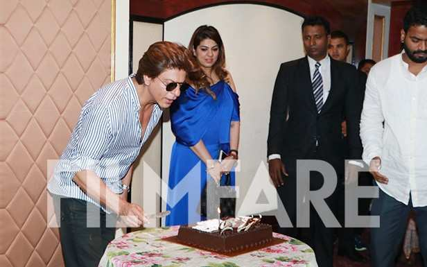 These pictures of Shah Rukh Khan cutting his birthday cake are just