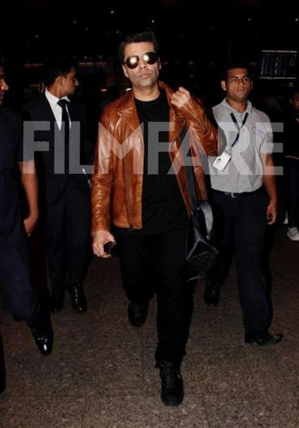 Karan Johar makes a stylish appearance at the airport