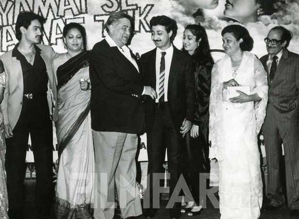 With Raj Kapoor at the launch of Qayamat Se Qayamat Tak in what was one of last few public appearances by the showman. Also seen on stage are Mansoor Khan and Nassir Hussain